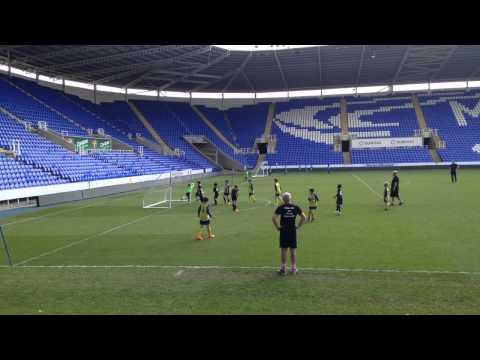 Royals Futsal U8 player scoring a cracking goal at Madejski Stadium May 15