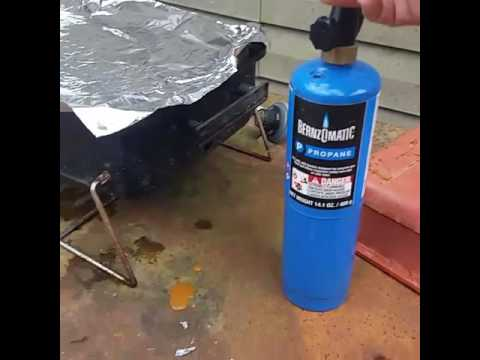 Burning aluminum foil with a torch