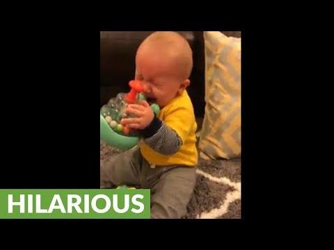 Baby throws temper tantrum because toy isn't edible