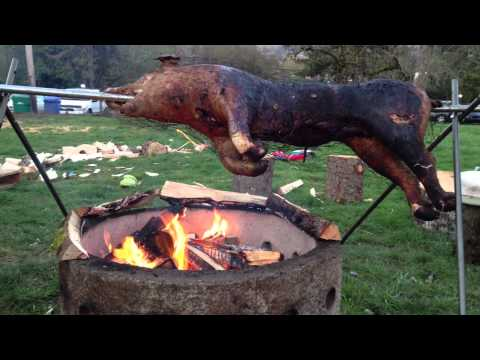 How To Roast A Pig, Roasting A Pig Over Fire :)