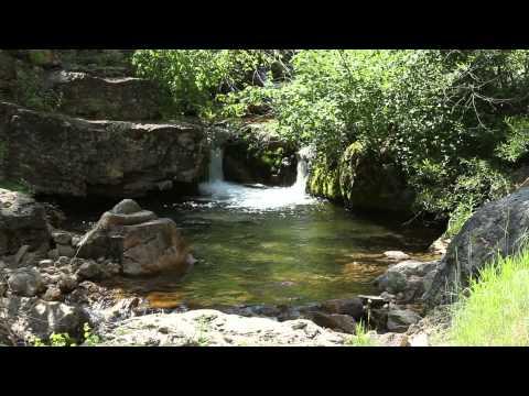 Water falls into a natural pool along Iron Creek
