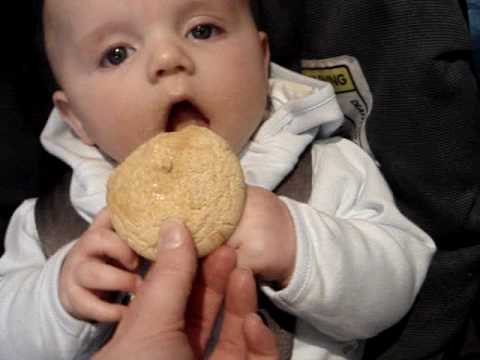 Baby eating his first rusk