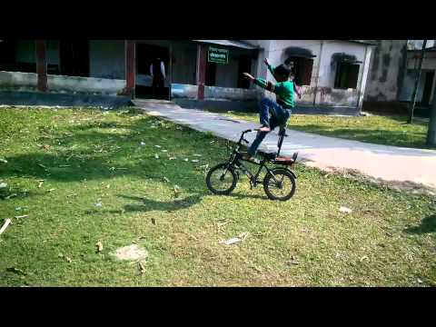 funny bicycle stant by a child 2015  (Shariatpur)