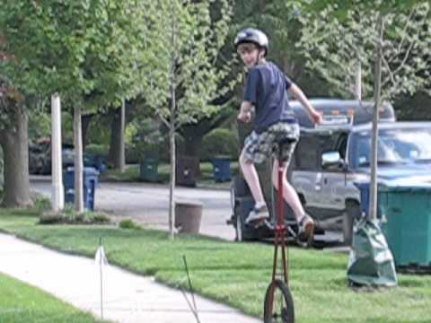 riding a 5 foot tall unicycle
