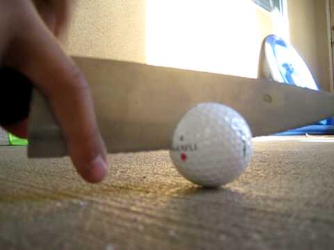 how to cut a golf ball in half