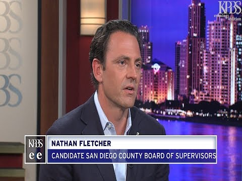 San Diego County Board of Supervisors candidate Nathan Fletcher talks with KPBS