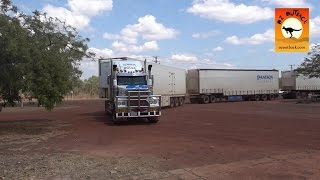 Massive road trains at roadhouses in outback Australia