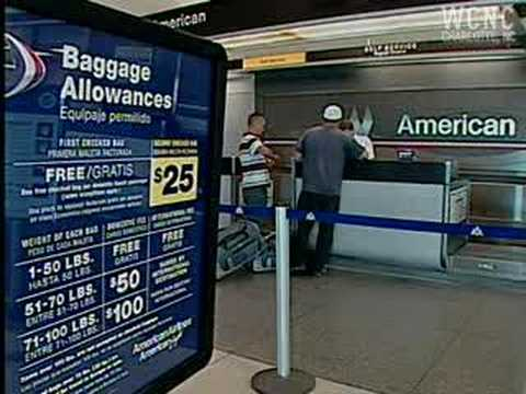 American Airlines begins charging to check bags