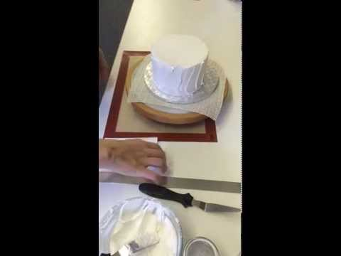 Coating a cake with royal icing (2nd layer)