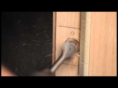 Installing a latch bolt strike plate non-mortise door - Video 6