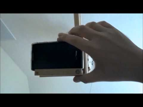 The Lazy Man's Clip-To-The-Bed Phone Holder