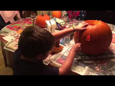 The boys carvin there pumpkins   Happy Halloween