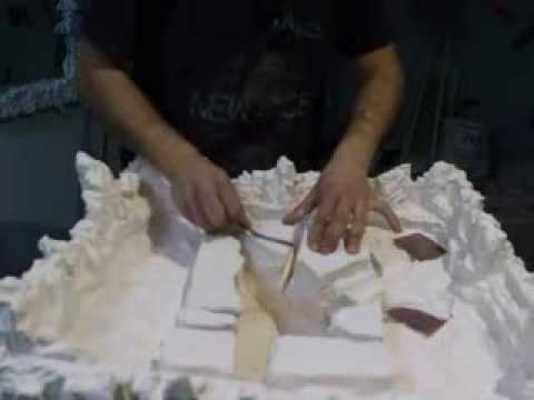 Making sanding to bottom of waterfall with sandpaper on waterfall project.