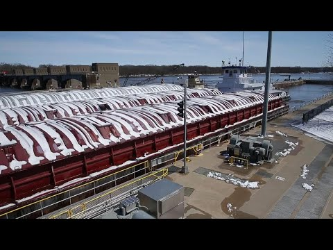 Time-lapse video of barge traffic going through lock on Mississippi River