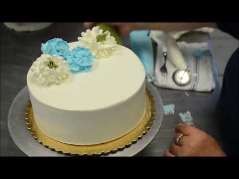 Cake decorating tutorial on how to design cream flowers on a birthday cake
