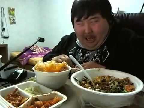 Asian guy laughing at his food  REALLY FUNNY