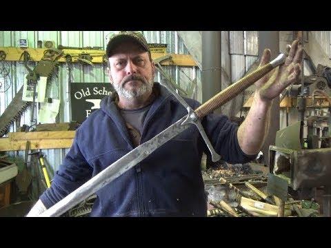 Blacksmithing Shorts - Claymore Pommel and Stacked Leather Handle