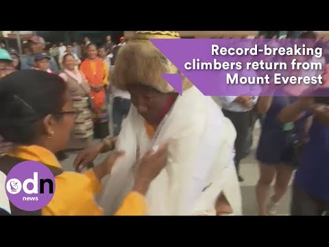 Record-breaking climbers return from Mount Everest
