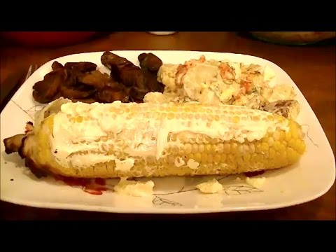 A How To Recipe for Making Corn on the Cob on a Charcoal Grill with the Husk on...So good!!