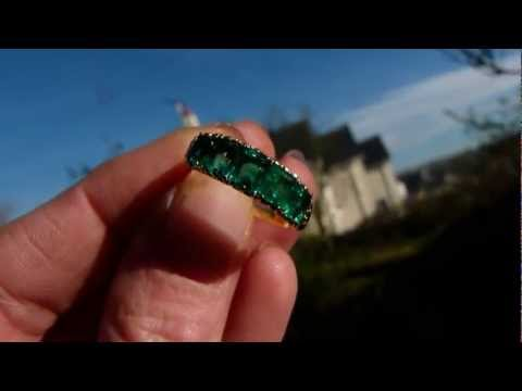 VERY FINE COLUMBIAN EMERALD ETERNITY RING.