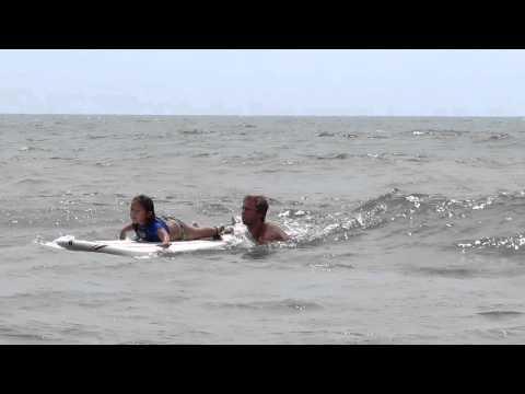 karsyn getting up on surf board