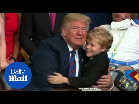 Young boy tries multiple times to give Trump a hug - Daily Mail