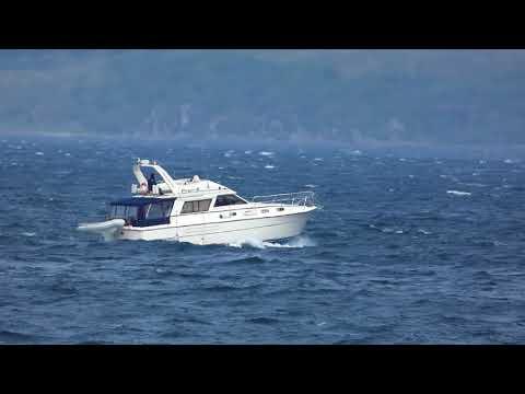 Boat sailing on windy day in Kilbrannan Sound Isle of Arran Scotland UK