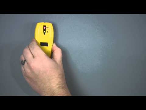How to Hang a Clock on a Wall Stud : Drywall Work