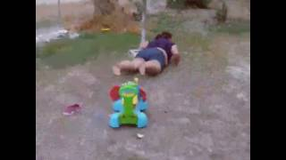 Woman Rides Toy Car Down Truck Ramp and Faceplants