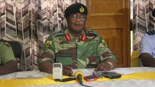 Military vehicles moved into Harare in an apparent military action