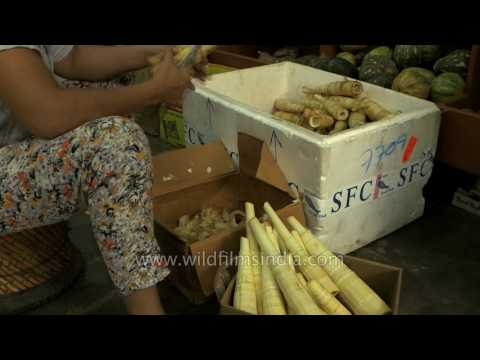 Cleaning fresh bamboo shoots for sale
