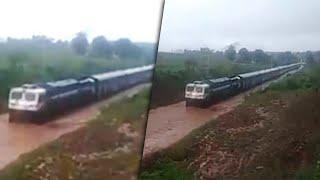 Train get stuck on waterlogged rail tracks in Odisha, Watch Video | Oneindia News