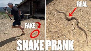 TERRIFYING SNAKE PRANK | DAD LOSES IT WHEN SON THROWS FAKE SNAKE AT HIM WHILE VIDEOING REAL SNAKE