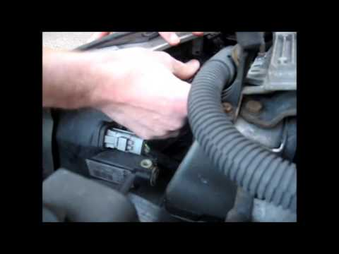How to change the headlight bulbs on a Peugeot (shown on a Peugeot 206)