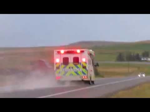 Alberta Health Services ambulances responding X2 and Blood Tribe Ambulance 2129 responding.