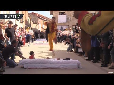 'Devil-men' jump over new-borns at Spanish festival