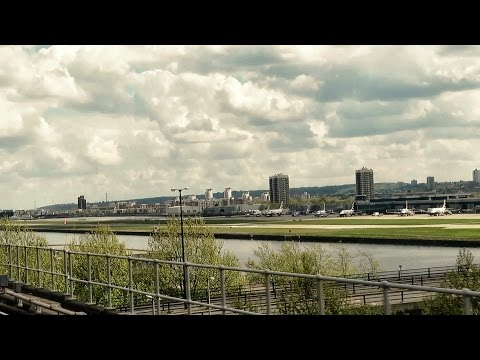 London. Riding the DLR Train from Tower Gateway to Beckton. View of London City Airport