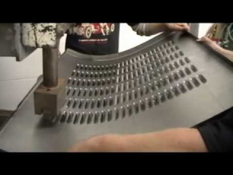 Punching louvers into a Ford Model A trunk lid. Louver press demo.