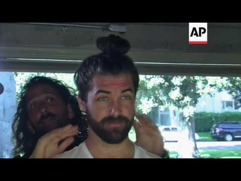 Men with long hair learn how to 'sport the bun'