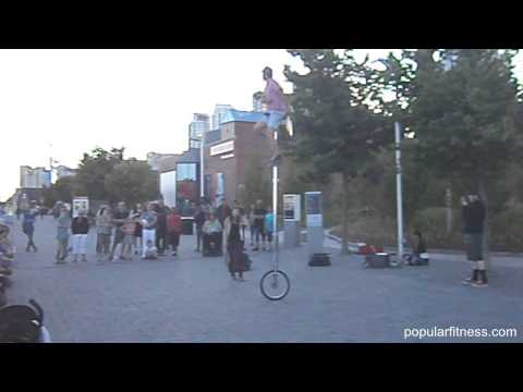 Busker Riding Very Tall Unicycle Juggling Swords - Harbourfront