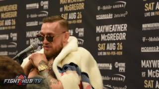 Conor McGregor thinking wether he wants to wear Boxing shorts or not