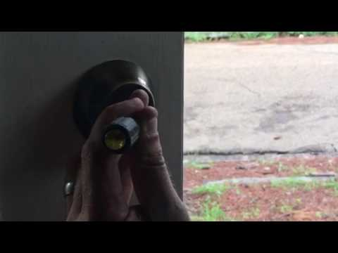 I can't get my Schlage Deadbolt off the door, no screw heads??!