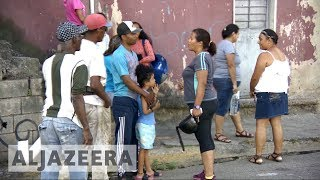 Venezuela sees uncertain future as second year of economic crisis
