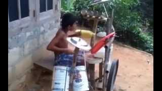 funny ...kid playing on homemade drum set
