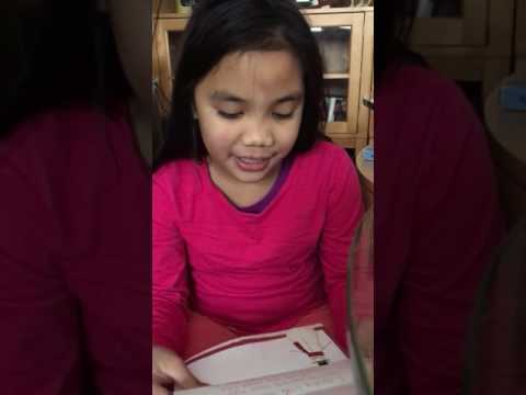 8 yr old girl recieve a letter from Santa for the first time