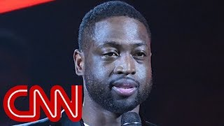 NBA star Dwyane Wade stands with massacre victims