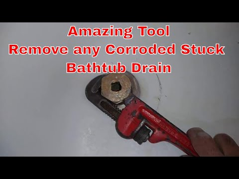 How To Remove and change an old stuck Bathtub Drain flange that's Rusted, Broken cross member