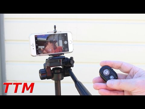Good iPhone or Smartphone Tripod Mount Adapter with Wireless Bluetooth Remote Control