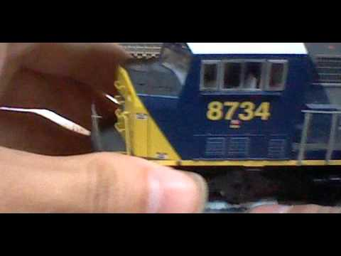 Cleaning Engine Wheels On A Set Of HO Scale Engines