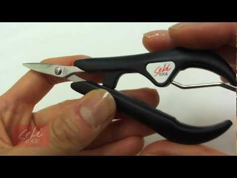 Cut acrylic nails with these serrated cutting edge scissors!